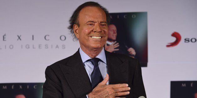 Spanish singer Julio Iglesias gestures before a press conference in Mexico city, on September 23, 2015....