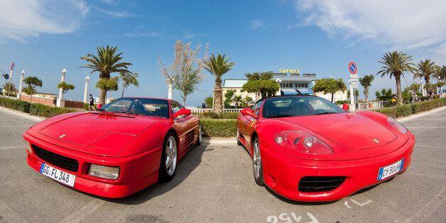 Giulianova, Italy - June 04, 2011: Ferrari supercars parked on the promenade of Giulianova, Italy, ready...