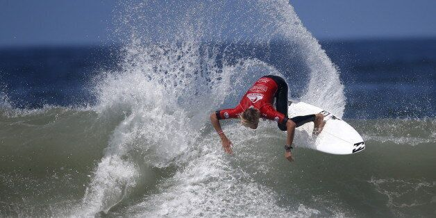 Gatien Delahaye competes in the man's final during the World Surf League's (WSL) Quiksilver Pro surfing...