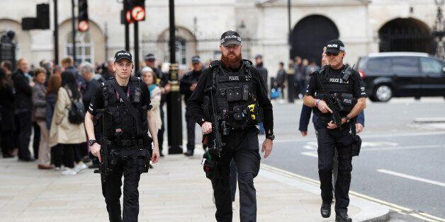 Armed police officers patrol in Westminster, in London, Britain, September 16, 2017. REUTERS/Peter
