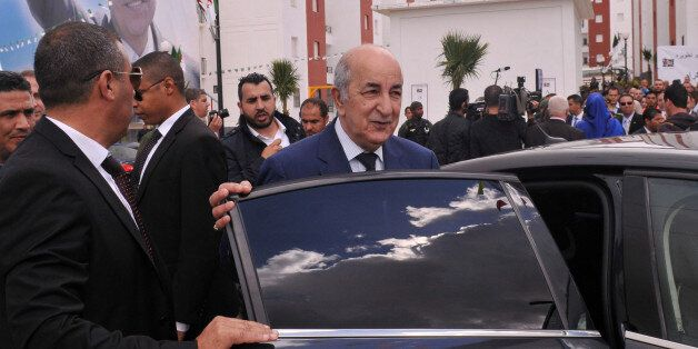 Algerian Housing minister Abdelmadjid Tebboune (C) is seen during the ceremony of social housing distribution...