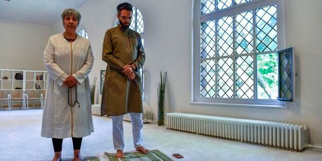 Openly gay French imam Ludovic-Mohamed Zahed (R) and German-Turkish lawyer, author and activist Seyran...