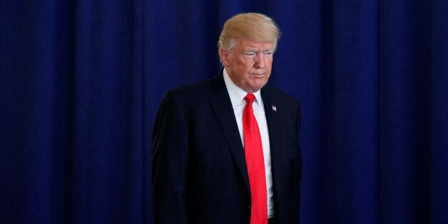 U.S. President Donald Trump arrives to deliver remarks on the protests in Charlottesville, Virginia,...