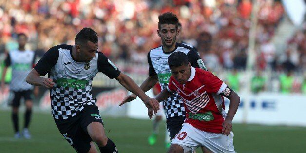 Bedrane Abdelkader (L) of ESS struggle for the ball with FehamBouazza (R) of CRB during final match of...