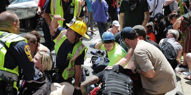 CHARLOTTESVILLE, VA - AUGUST 12: Rescue workers and medics tend to many people who were injured when...