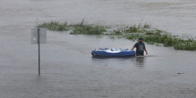 A resident wades through flood waters from tropical storm Harvey in east Houston, Texas, U.S., August...