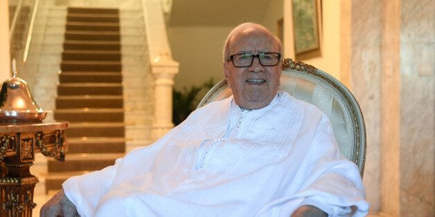 Tunisian President Beji Caid Essebsi poses for a picture in traditional costume at the official house...