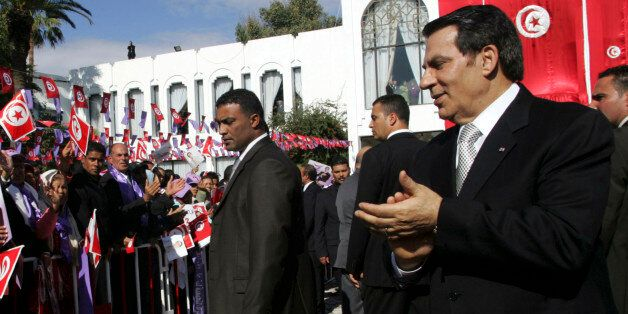 Tunisia's President Zine al-Abidine Ben Ali (R) meets supporters after he took the oath at the national...