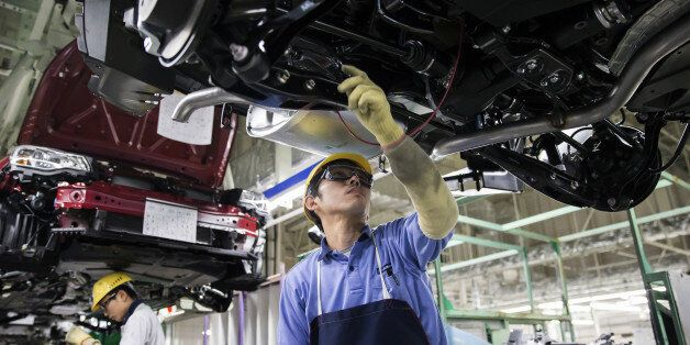 Workers assemble Subaru branded vehicles on the production line of Fuji Heavy Industries Ltd.'s Gunma...