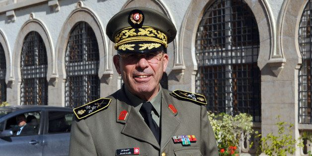 The head of the Tunisian armed forces General Rachid Ammar poses in front of his office at the ministry...