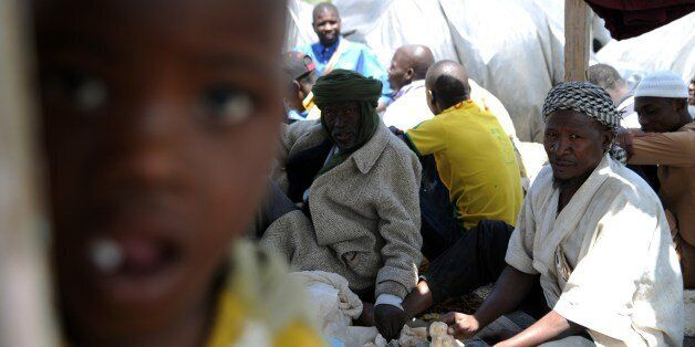 Illegal migrants from Niger sit next to their tents on May 14, 2014 after settling, some of them for...