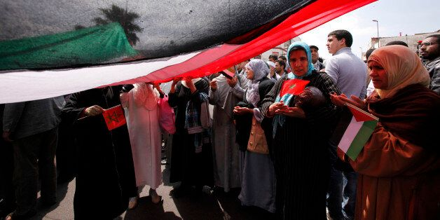 Moroccans attend a pro-Palestinian march, to