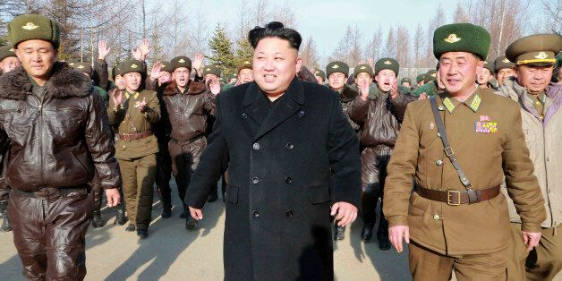 North Korean leader Kim Jong Un walks as he inspects the KPA Air and Anti-Air Force Unit 991, honoured...