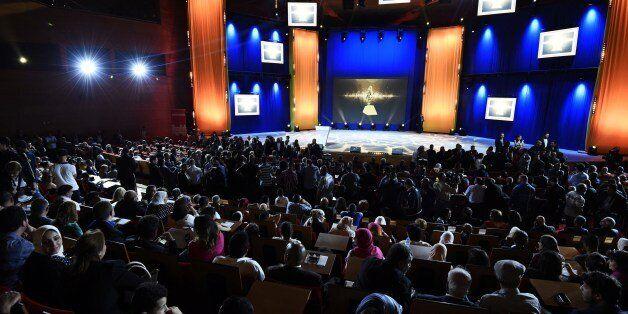 People attend the 8th International Arab Film Festival (FIOFA) on June 3, 2015, in Oran Algeria. A total...