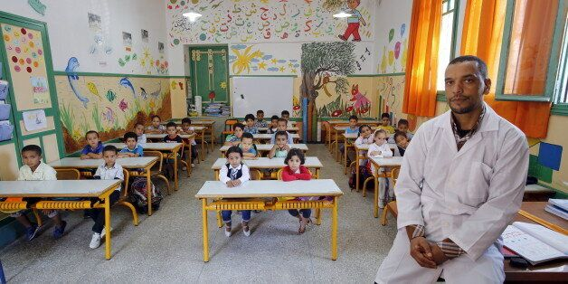 Teacher Moulay Ismael Lamrani poses for a picture with his class in the Oudaya primary school in Rabat,...