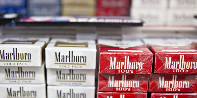 Philip Morris Marlboro brand cigarettes are displayed for sale at a gas station in Tiskilwa, Illinois,...