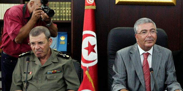 Tunisia's Armed Forces General Rachid Ammar (L) and Tunisian Defence Minister Abdelkarim Zbidi attend...