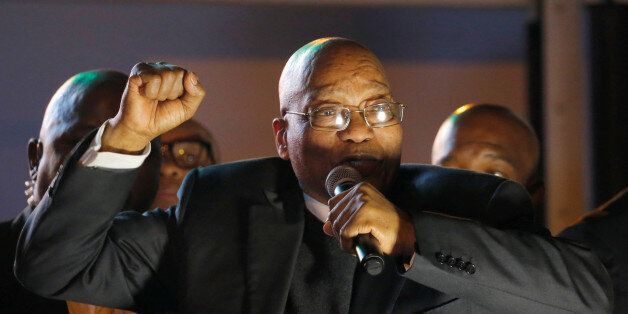 South Africa's President Jacob Zuma celebrates with his supporters after he survived a no-confidence...