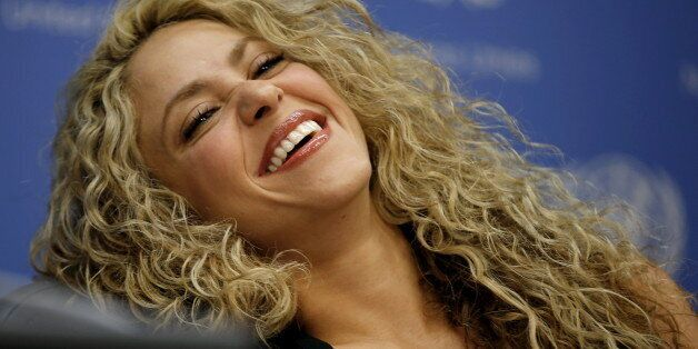 Colombian singer and UNICEF Goodwill Ambassador Shakira laughs during a news conference at United Nations...
