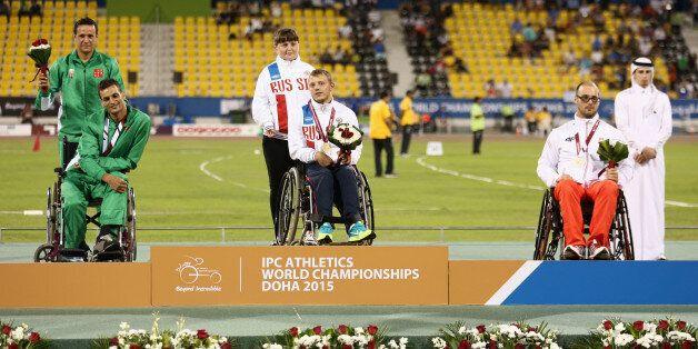 DOHA, QATAR - OCTOBER 26: Vladislav Frolov of Russia poses with his gold medal, Lahouari Bahlaz of ALgeria...