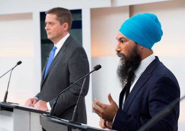 NDP Leader Jagmeet Singh speaks as Conservative Leader Andrew Scheer looks on during the Maclean's/Citytv...