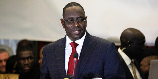 Senegalese opposition presidential candidate Macky Sall speaks at a celebratory news conference in the...