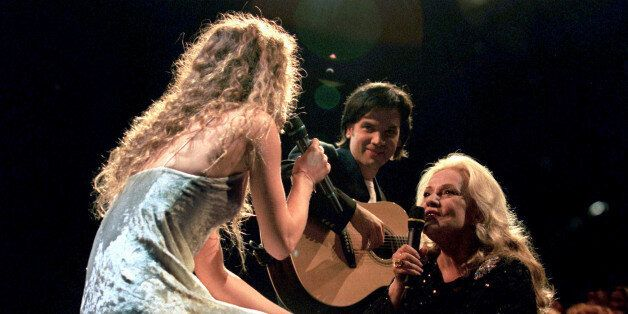 FILE PHOTO - Jeanne Moreau (R), President of the Jury at the 48th Cannes Film Festival, sings with Vanessa...