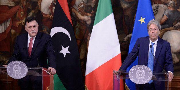 ROME, ITALY - JULY 26: Prime Minister Paolo Gentiloni with Libyan Prime Minister Fayez al-Sarraj at Palazzo...