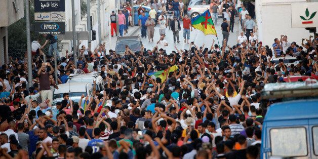 Protesters shout slogans during a demonstration against alleged corruption in the town of Al-Hoceima,...