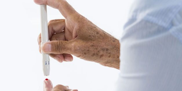 In this photo illustration it shows - Diabetes test senior. (Photo Illustration by: Media for Medical/UIG...