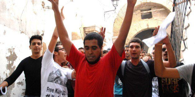 Tunisian rapper Ahmed Ben Ahmed (C), aka Klay BBJ, reacts following his released from custody on October...