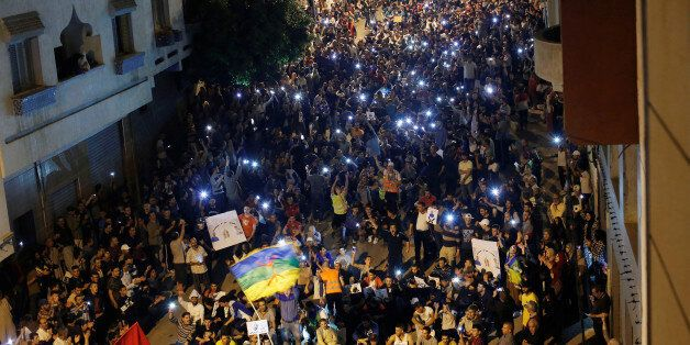 Thousands of protesters shout slogans during a demonstration in the northern town of Al-Hoceima against...