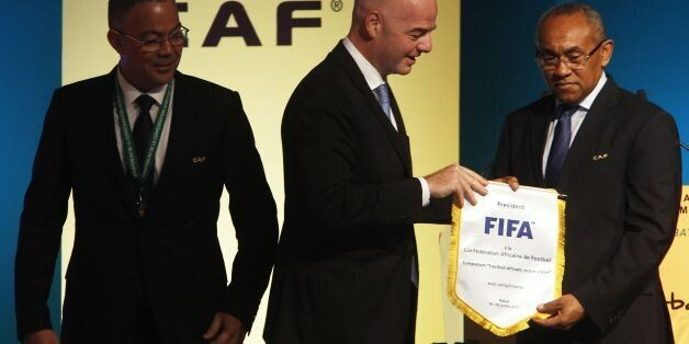 Recently elected president of the African Football Confederation (CAF) Ahmad Ahmad (R), FIFA president...
