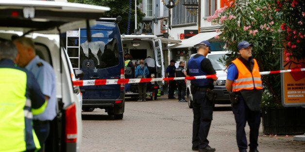 Swiss police officers stand at a crime scene in Schaffhausen, Switzerland July 24, 2017. REUTERS/Arnd
