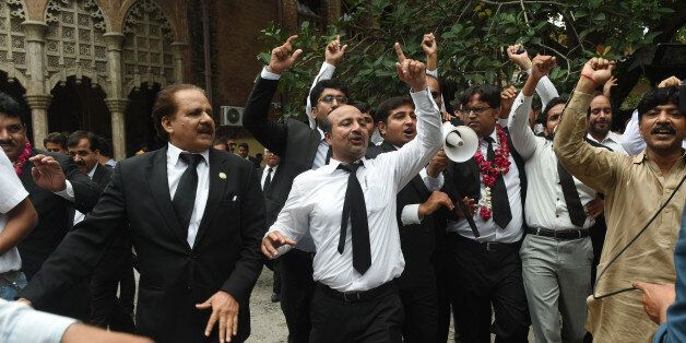 Pakistani lawyers celebrate the Supreme Court (SC) against Prime Minister Nawaz Sharif, in Lahore on...