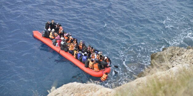 Kas,Turkey - January 16, 2016, Coast line between Kalkan Kas at 09:45. An inflatable boat filled with...