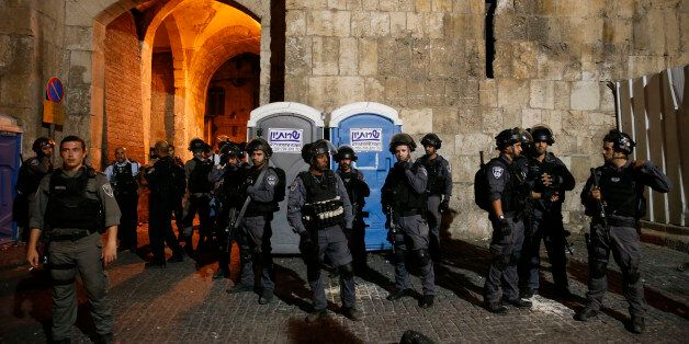 Israeli security forces stand guard outside the Lion's Gate, a main entrance to the Al-Aqsa mosque compound...