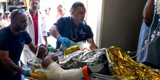 Emergency workers use a trolley to take as a person injured in an earthquake on the Greek island of Kos...