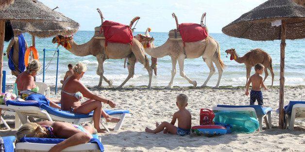 Tourists relax on a beach on the island of Djerba, Tunisia, September 7, 2016. REUTERS/Zoubeir