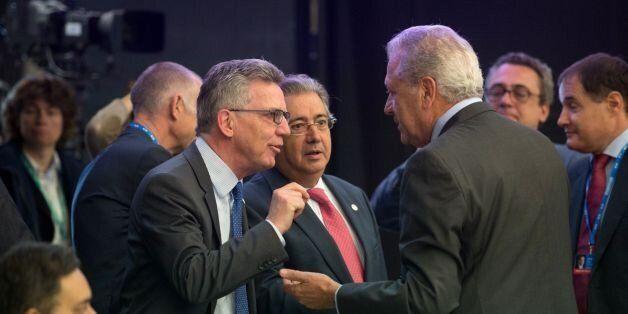 German Interior Minister Thomas de Maiziere (L) and his Spanish counterpart Juan Ignacio Zoido (C) talk...