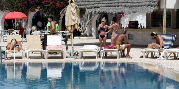 European tourists sunbathe at a hotel in the southern Mediterranean Tunisian resort island of Djerba,...