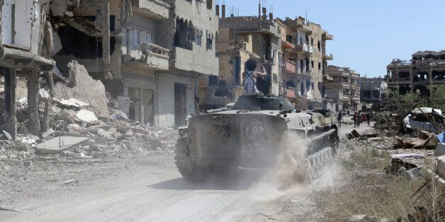 A tank belonging to special forces of the Libyan army enter the area of clashes with Islamist militants...