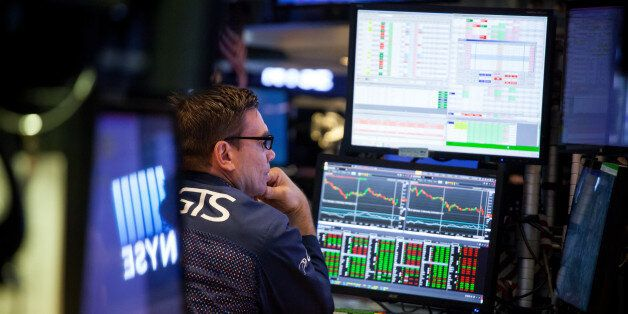 A trader works on the floor of the New York Stock Exchange (NYSE) in New York, U.S., on Friday, June...