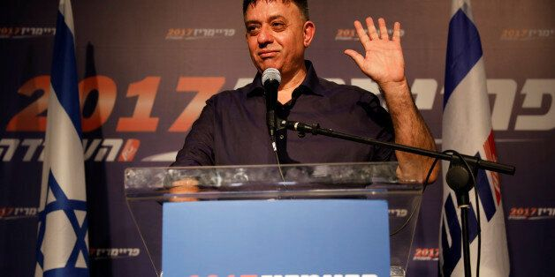 Avi Gabbai, the new leader of Israel's centre-left Labour party, gestures as he delivers his victory...