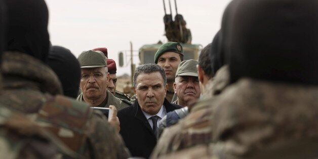 Tunisian Defense Minister Farhat Horchani (C) speaks to soldiers in Sabkeht Alyun, Tunisia February 6,...
