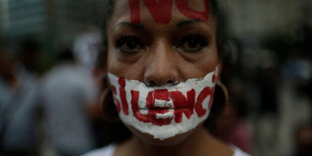 MEXICO CITY, MEXICO - JUNE 15: A woman with a writing on her face that reads 'no to silence' looks at...
