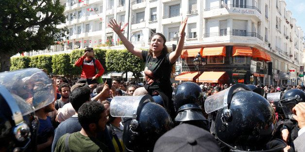 Law students shout slogans during a demonstration against the government in Tunis, Tunisia April 14,...