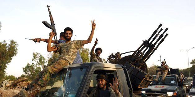 Members of the Salah Bou-Haliqa brigade, loyal to the country's east strongman Khalifa Haftar's self-styled...