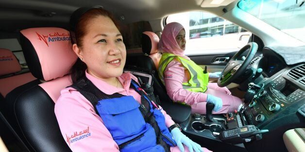 Philippines doctor Maria Lagbes sits in a pink ambulance of the Women Responders team in Dubai on July...