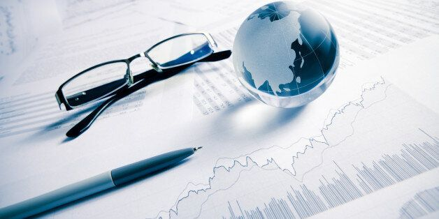glass globe ( asia map) with stock charts, pen and eye glass, business